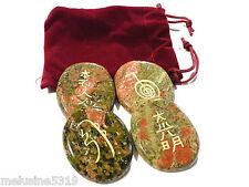 Lithothérapie  galets pierre massage soin unakite symboles du reiki