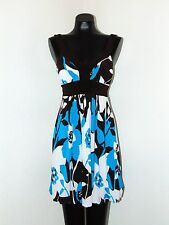 Beautfiul Turquoise and brown dress by Bisou Bisou in size 6