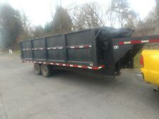 slightly used black metal gooseneck dump trailer