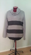 Knitted Ladies long sleeve winter top with loose roll neck