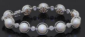 14K white gold elegant high fashion .56CTW diamond & 9mm pearl link bracelet