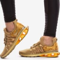 NIKE WOMENS SHOX GRAVITY Sneakers Gold & Red Crush SIZE 7,  9.5, 10, 11 M NEW