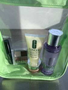 New Clinique 5 piece gift set beauty essentials with clear  panels makeup bag.