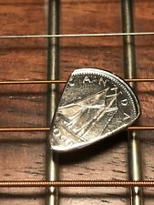 HAND CUT GUITAR PICK FROM A CANADIAN DIME TEN CENT COIN HAND CUT AND POLISHED