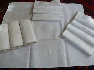 11 anciennes serviettes de table damas de lin début XXème mono brodé C.B tbé