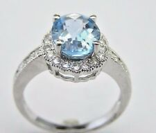 14 KT WHITE GOLD BLUE TOPAZ LADY'S RING WITH 0.30 CT DIAMOND