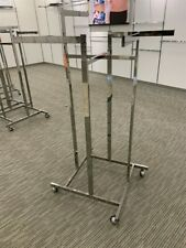 Store Display Fixtures High Capacity Four Arm Clothing Display Rack on Rollers