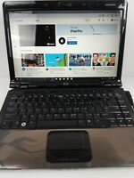"""Hp dv2000 laptop 14"""" inch, with Office installed, works fine ready to go."""