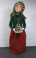 Byers Choice The Carolers Girl Holding Church Green Top, Red Skirt, 13 inch