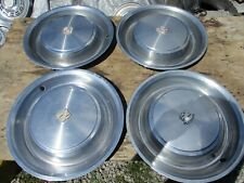 "USED 1973 CADILLAC 15 "" WHEELCOVER SET/FOUR USABLE UNITS/ONE HAS DAMAGED/SPOT"