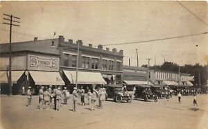 H57/ Larimore North Dakota RPPC Postcard c1910 Mercantile Band Parade  77