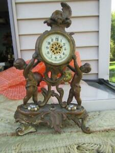 """Victorian Ornamental whit Two Cherubs Clock by New Haven Clock Co. 10"""" Tall"""