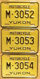 Three Yukon Motorcycle Plates Number Tag Plate Lot