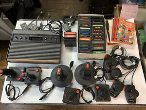 Vintage Atari 2600 Console 29 Games 9 Remotes And Instruction Books