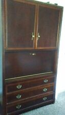 Large entertainment center in mahogony finish wood