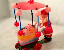 Vintage Christmas Wind Up Celluloid Santa Claus Tin Litho Rolling Vehicle Toys