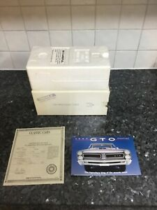 DM 1965 Pontiac GTO both presentation boxes with Car title and Brochure (No Car)