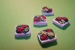 oo gauge eight square stone flower beds.