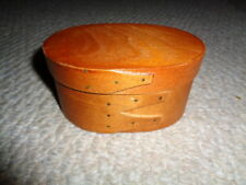 Hand made small shaker box oval shape lid brass nails pine light color stain.