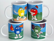 SET OF 4 GALLERIE M&M COFFEE MUGS FEATURING M&M BASEBALL AND GOLF PLAYERS