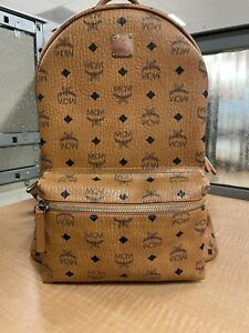 MCM backpack Large Cognac with dust bag and warranty/cleaning envelope.