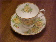 "ROYAL ALBERT ""TEA ROSE"" YELLOW CUP AND SAUCER"