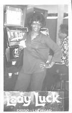 "LAS VEGAS NV ""LADY LUCK CASINO"" AFRICAN-AMERICAN WOMAN PLAYING SLOT MACHINE RPPC"