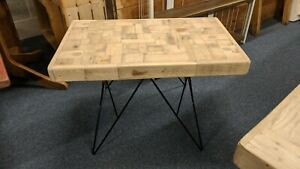 Chunky block coffee table handcrafted from reclaimed wood on metal legs