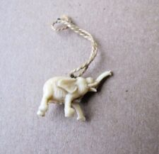 Vintage elephant celluloid pendant with string Japan 8510D