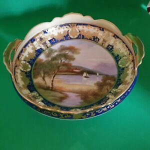 A EXQUISITE HAND PAINTED AND HEAVY GILDED NORITAKE TWIN HANDLED BOWL