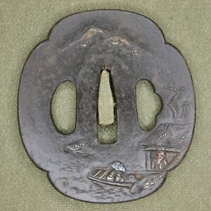Iron Tsuba with gold and silver inlays, Men, Boat, River.