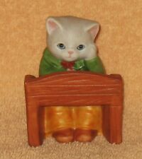 Kitty Cucumber Sitting At School Desk Mnb