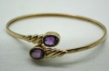 Lovely 9 carat Gold And Large Amethyst Torque Style Bangle