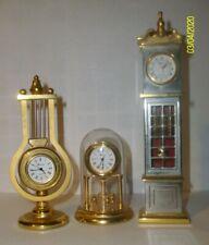 A SET OF THREE GORHAM DECORATIVE COLLECTABLE BRASS CLOCKS