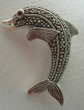 NICE 925 SILVER & MARCASITE LEAPING DOLPHIN BROOCH WITH RED STONE SET EYE