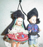 Pair of Vintage Miniature Plastic Boy and Girl Dolls