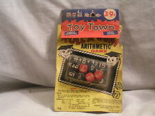 TOY TOWN ROLL A SUM ARITHMETIC GAME IN THE PACKAGE.