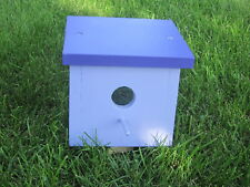 Hand-crafted wooden nest view birdhouse