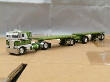 1/64 Dcp CUSTOM single axle green/white Peterbilt 352 w/double hay pups