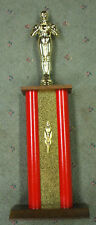 Male achievement trophy award painted red metal column wood base