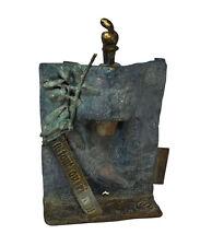 Sculpture bronze de Tomek patine bleue et médaille