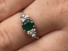 Emerald Ring with six cubic zirconia on a 9ct Gold Shank