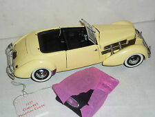 A Franklin mint scale model car of a 1937 Cord  812 Phaeton coupe, boxed