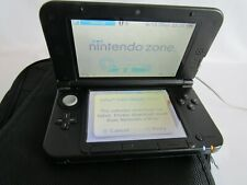 Nintendo 3DS XL with 9 games charger, & shoulder strap carry bag