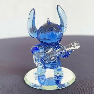 Stitch in Blue glass and his guitar figure on mirror,Arribas Disneyland Paris
