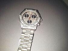 TAG Heuer Quartz (Automatic) Round Wristwatches
