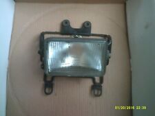suzuki dr tsr tsx unknown headlight and mount bracket