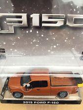 Greenlight   2015 Ford F-150  w/ Plow & Spreader.  Copper