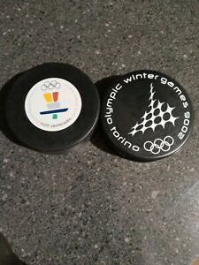 2006 and 2010 Official Olympic Hockey Puck Lot (2).