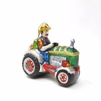 European Style Farmer Riding Tractor Holiday Blown Glass Christmas Ornament